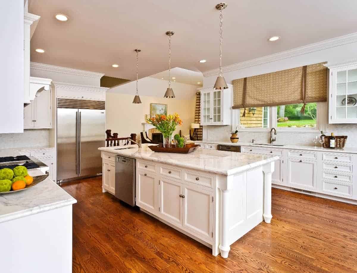 Carrara marble counters, high-end stainless steel appliances and white custom-built kitchen cabinets