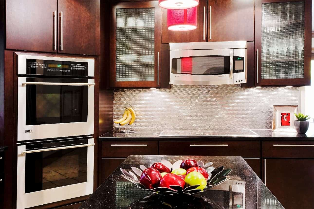 This Stainless-Steel backsplash with herringbone pattern provides a unique focal point to an otherwise understated kitchen in Dix Hills NY