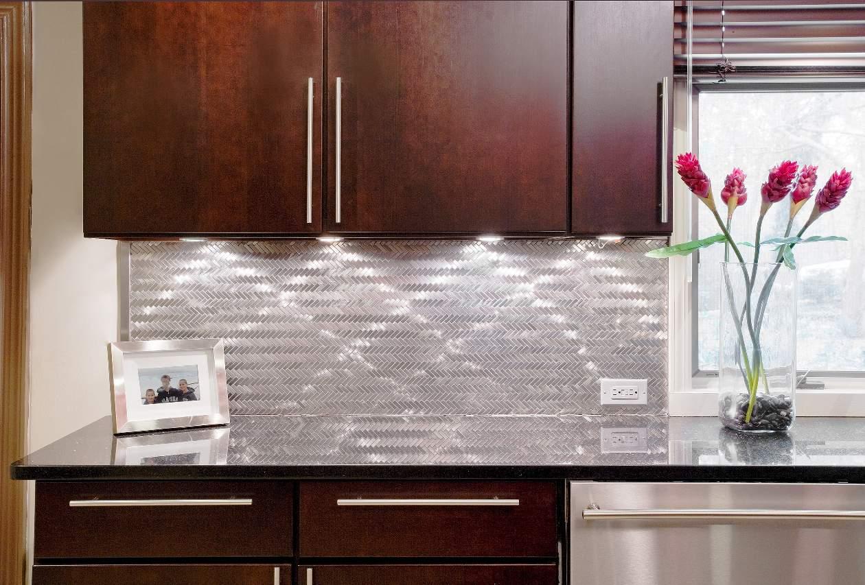 stainless steel contrasts rich dark wood cabinets, Dix Hills kitchen design.