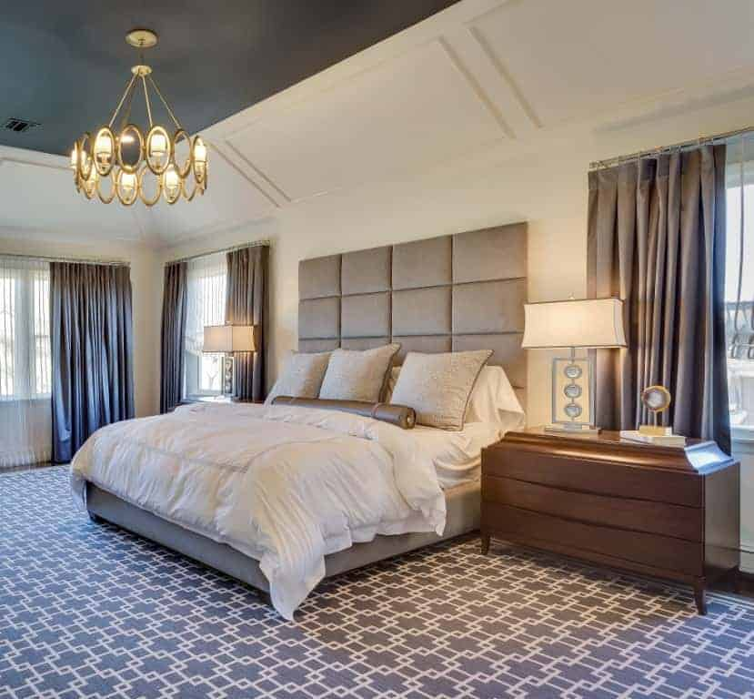 A neutral color palate creates a sophisticated yet serene private retreat in this Woodbury NY master bedroom suite.