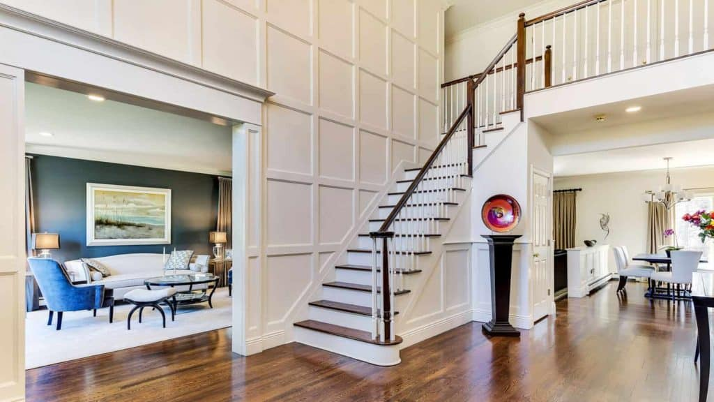 Dramatic foyer entrance, Fort Salonga NY by Robyn B of Interiors By Just Design Woodbury NY