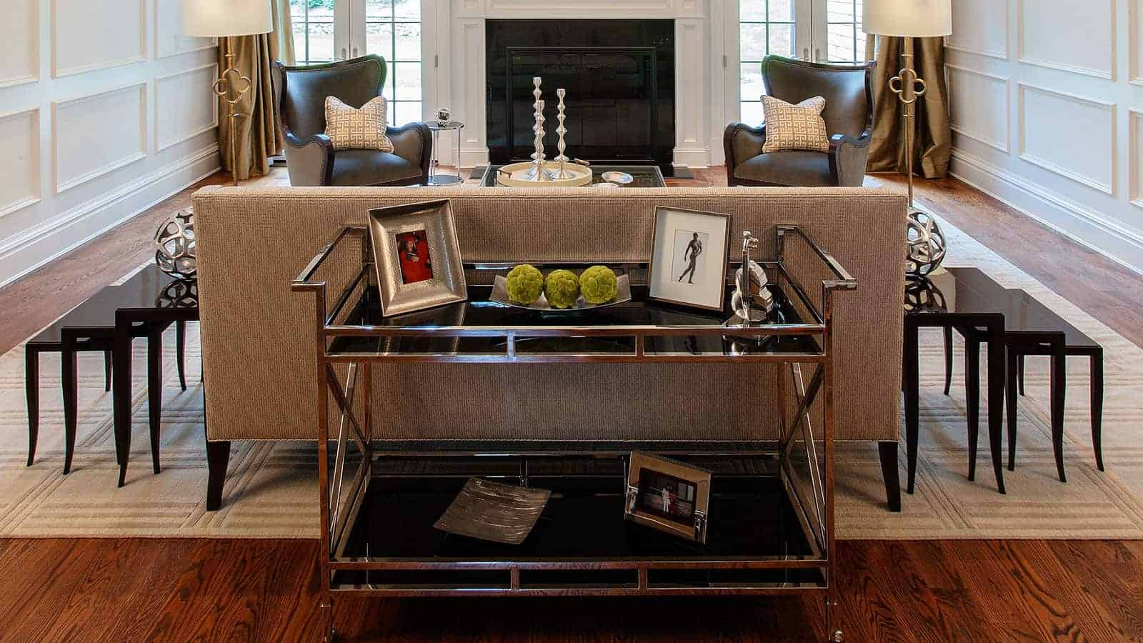New construction residence, Old Westbury NY. Christopher Guy end tables, custom drapery. The panel moulding off-white walls warms up the space and is enhanced by the dark hardwood floors. Interior Design by Robyn B of Interiors by Just Design, Woodbury Long Island NY.